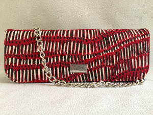 Ebony clutch featuring Fish Trap by Aboriginal artist Kieren( Karritpul) McTaggart , Merrepen Arts