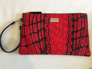 Zara purse/clutch featuring crocodil by Aboriginal artist Aaron McTaggart, Merrepen Arts