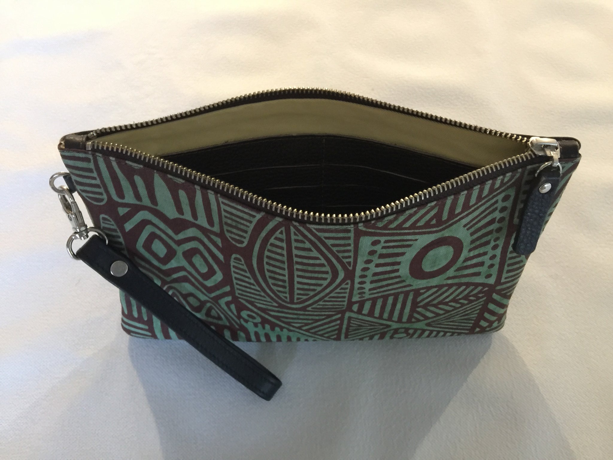 Zara Purse featuring Stone Axe by Aboriginal artist Danny Munkara, Tiwi Designs ( Sample stock)