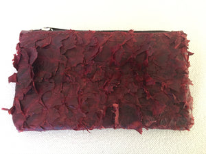 Lily purse featuring claret ruffled barramundi