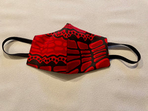 Face mask featuring Crocodile by Aboriginal artist Aaron McTaggart, Merrepen arts