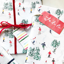 Load image into Gallery viewer, christmas gifts wrapped in skiers watercolor wrapping paper the illustrated life