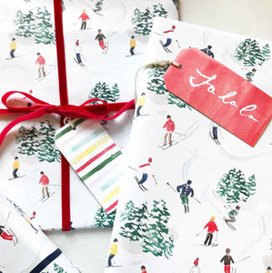 christmas gifts wrapped in skiers watercolor wrapping paper the illustrated life