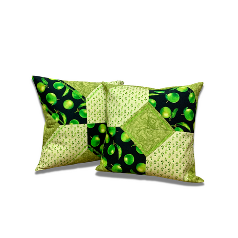 Picture of two pillows with Tic Tac shapes quilted and sewn - a sewing kit.
