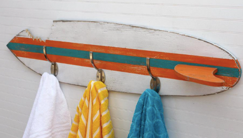 upcycled surfboard into towel rack