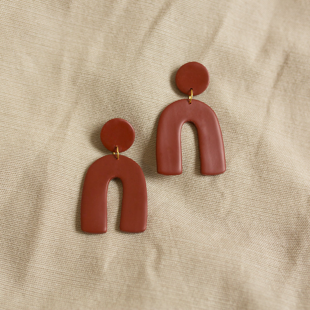 arch earrings in earth