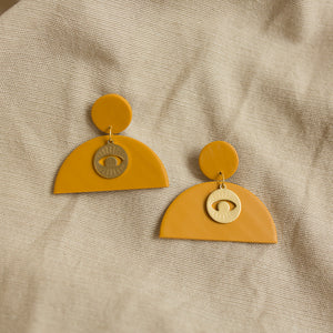 moon eye earrings in sun