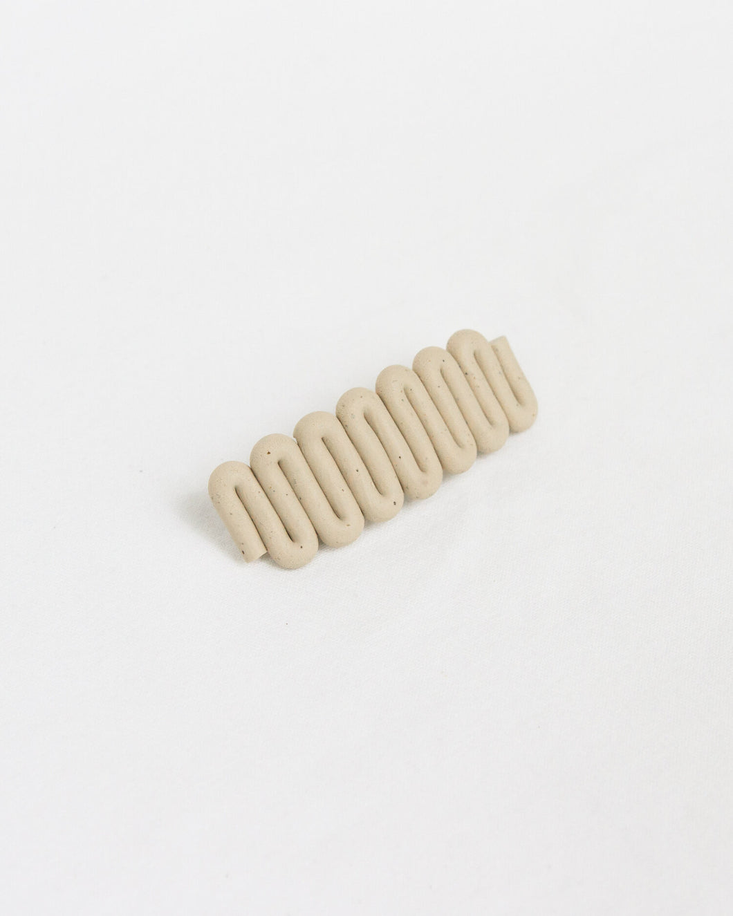 clay barrette in oat