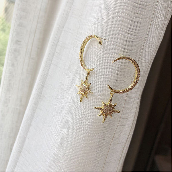 Crystal encruted star and crescent stud earrings in 14 ct gold plate