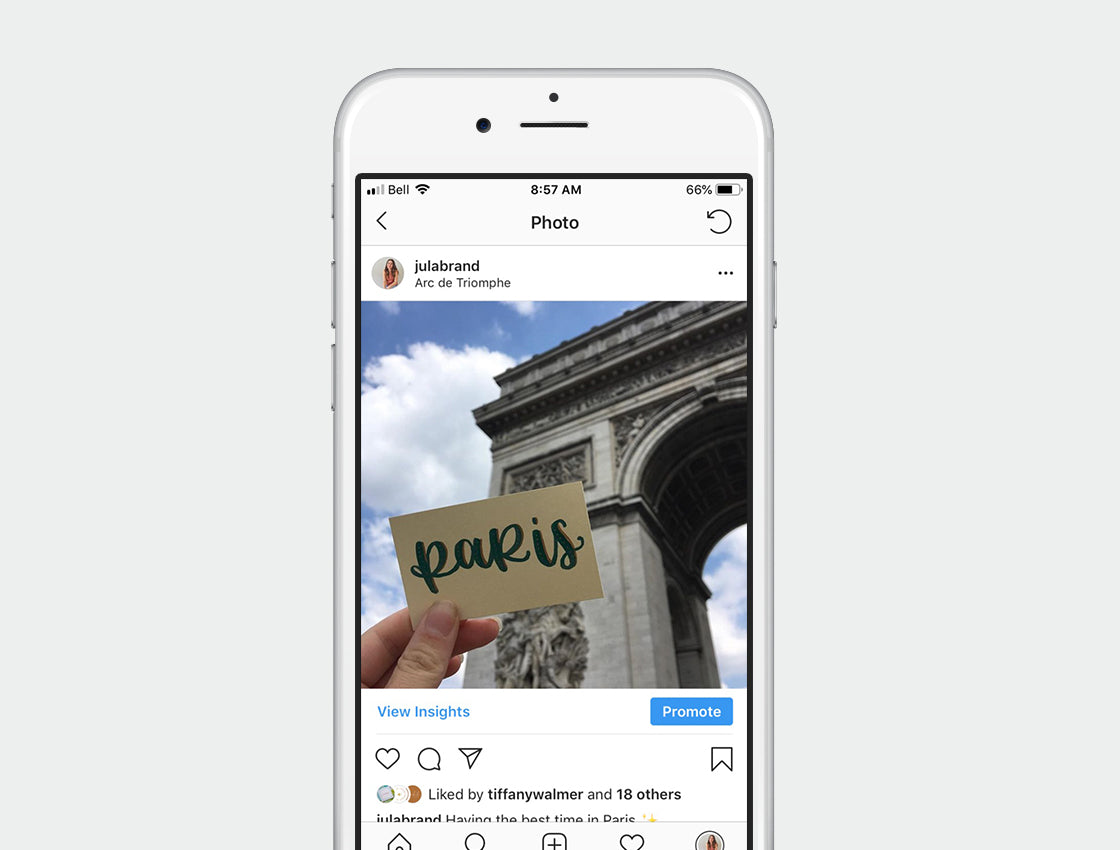 Iphone mockup with photo of arc de triomphe in paris france and modern calligraphy