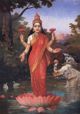Hindu goddess Lakshmi holding and standing on a lotus.