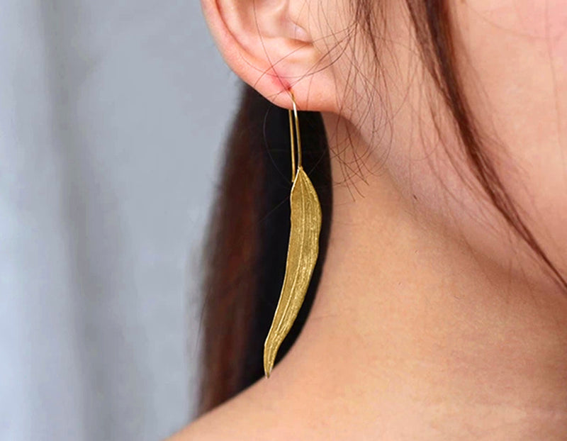 Girl wearing Gold Autumn Leaf Earring - Lotus Fun