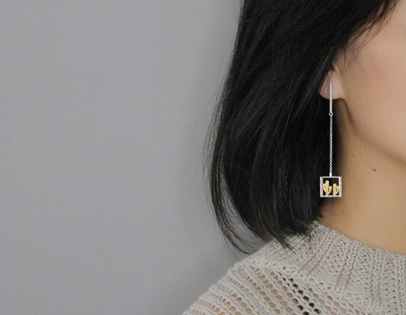 Girl Wearing Cactus Earring - Lotus Fun