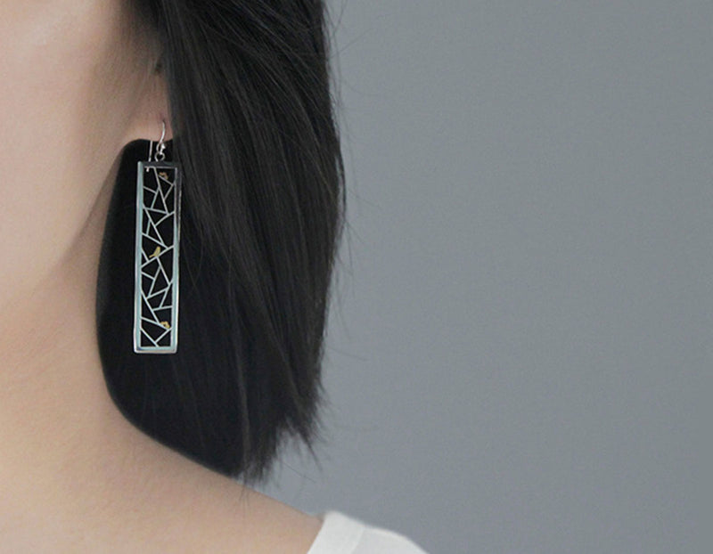 Girl wearing Bird Kiragami Earring - Lotus Fun