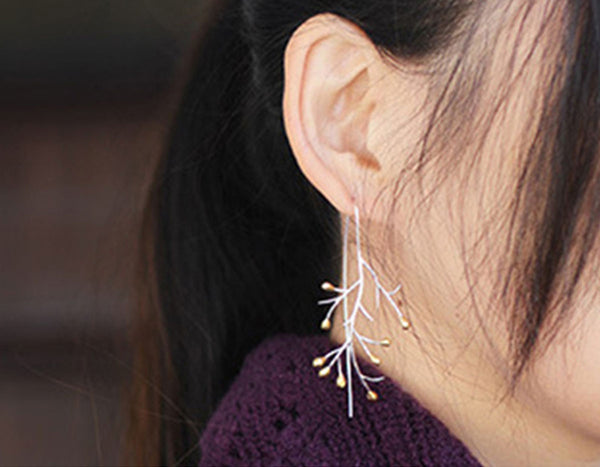 Girl wearing Autumn Tree Branch Earring - Lotus Fun
