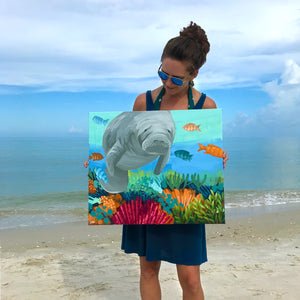 "Dora Knuteson with her manatee painting ""White Whiskers"""