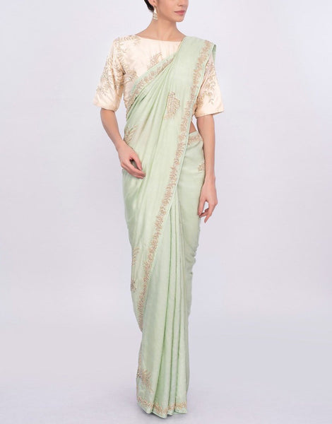Pista mint green silk saree with cut dana and moti embroidery and butti