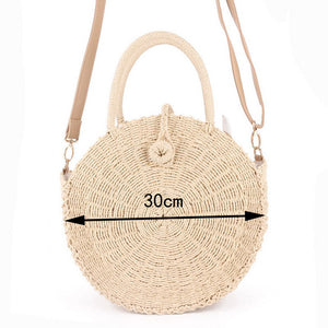 Earthcessories round handmade rattan handbag by carved nature beige