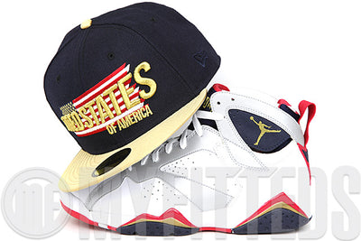 United States of America Midnight Navy Metallic Gold To the Victor Goes Gold Air Jordan VII Olympic New Era Hat