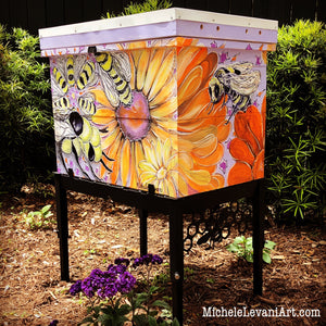 Custom hand painted beehive, by Charleston artist, Michele Levani