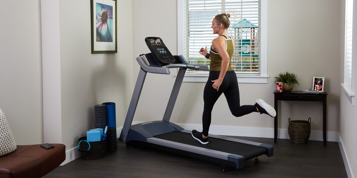 Man running on a Precor TRM 731 interval professional treadmill with Integrated Footplant Technology