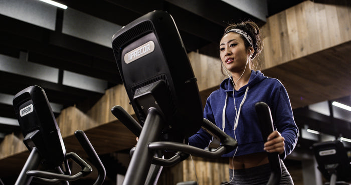 Virtual Tour of Precor - woman working out in a fitness facility on a Precor elliptical EFX 885