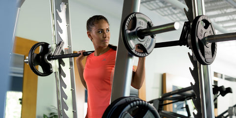 Female strength training in home gym