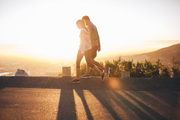 A couple walking along the shore for morning exercise