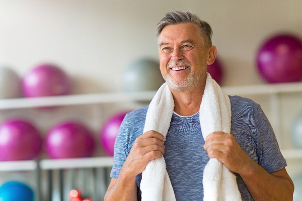 Middle aged man exercising to reduce effects of aging