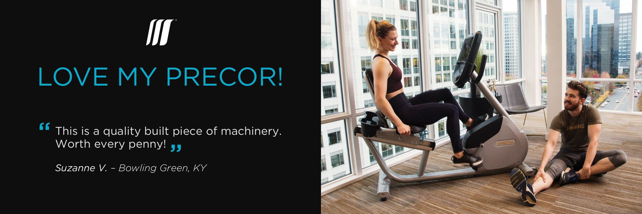 Home exerciser working out on a Precor recumbent bike RBK with their partner stretching on the floor next to them in their home workout room