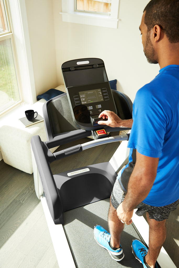 Close-up of a man changing the incline on his R40-console during his workout on his Precor TRM 445 treadmill