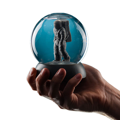 Astronaut Brainteaser Globe Game Glass In Hand Image