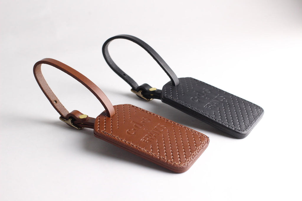 Isaac Francis x C·D·S Luggage Tag Collab in Dark Brown. Compendium Design Store, Fremantle. AfterPay, ZipPay accepted.