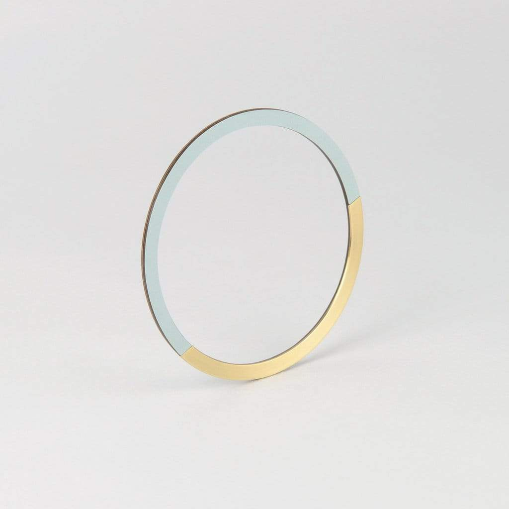 Tom Pigeon Form Series circle bangle in brass & ice blue. Tom Pigeon. Compendium Design Store. AfterPay, ZipPay accepted.