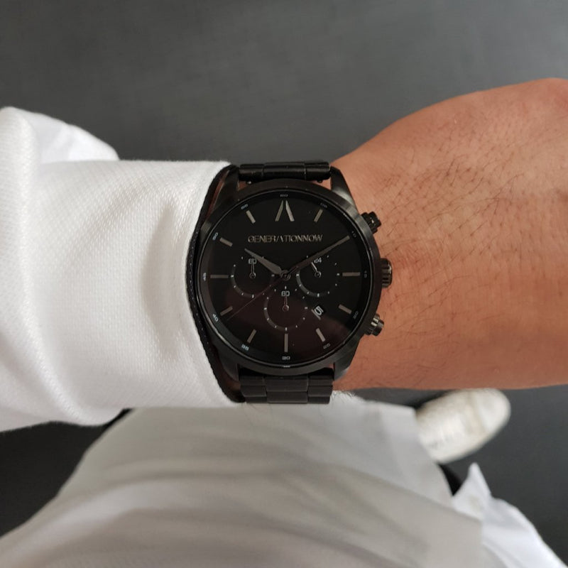 Black Stainless Steel Chronograph Watch with a black Full Grain Leather Strap for men by GenerationNow, Model The Dark Knight, worn by model