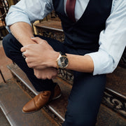 Gold and black Stainless Steel Classic Watch with a black Full Grain Leather Strap for men by GenerationNow, Model Achilles, worn by model