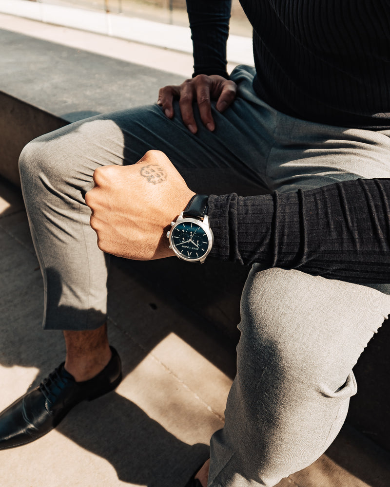 Silver and black Stainless Steel Chronograph Watch with a black Full Grain Leather Strap for men by GenerationNow, Model Prometheus, worn by model