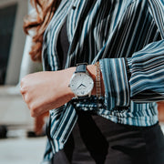 Blue, white and silver Stainless Steel Classic Watch with a blue Full Grain Leather Strap for women by GenerationNow, Model Calypso, worn by model