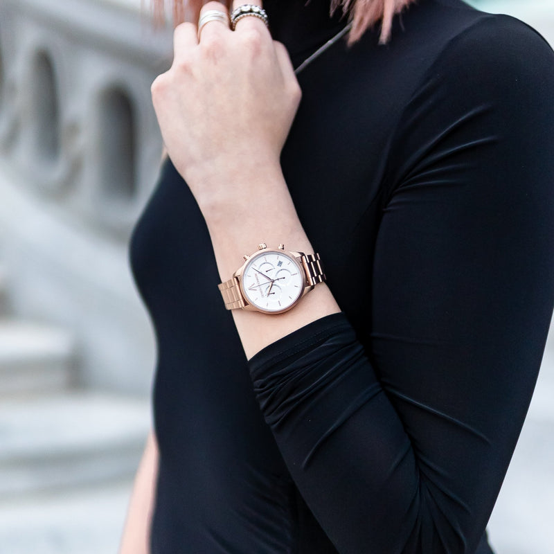 Rose pink and white Stainless Steel Chronograph Watch with a pink Full Grain Leather Strap for women by GenerationNow, Model Aphrodite, worn by model