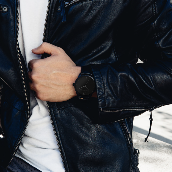 Black Stainless Steel Classic Watch with a black Full Grain Leather Strap for men by GenerationNow, Model The Drak Knight, worn by model