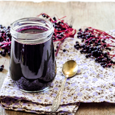 Elderberry syrup with raw honeycomb