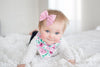 Pink floral design, cotton and polyester absorbent bandana bib