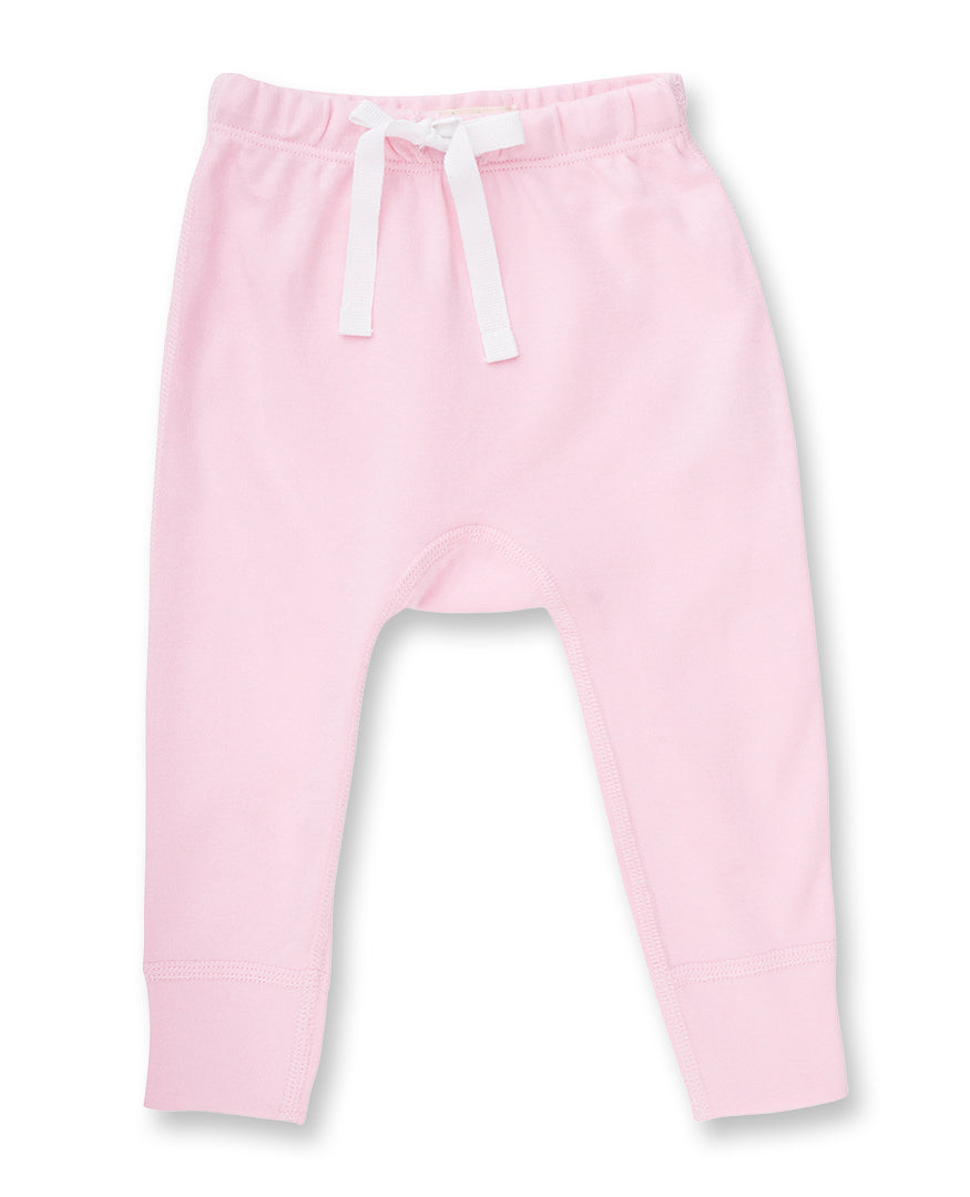 light pink newborn pant with drawstring waist and white heart decal on bottom