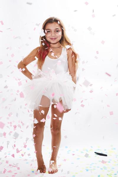 White tutu with lots of tulle and snap closures