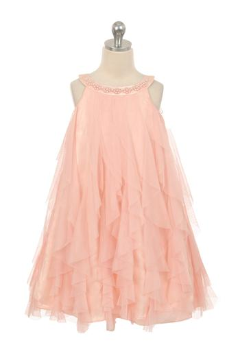 Pink sleeveless girls dress with layers of frilly fabric, accented with beads