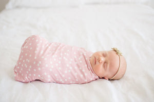 Pink and white polka dot swaddle blanket