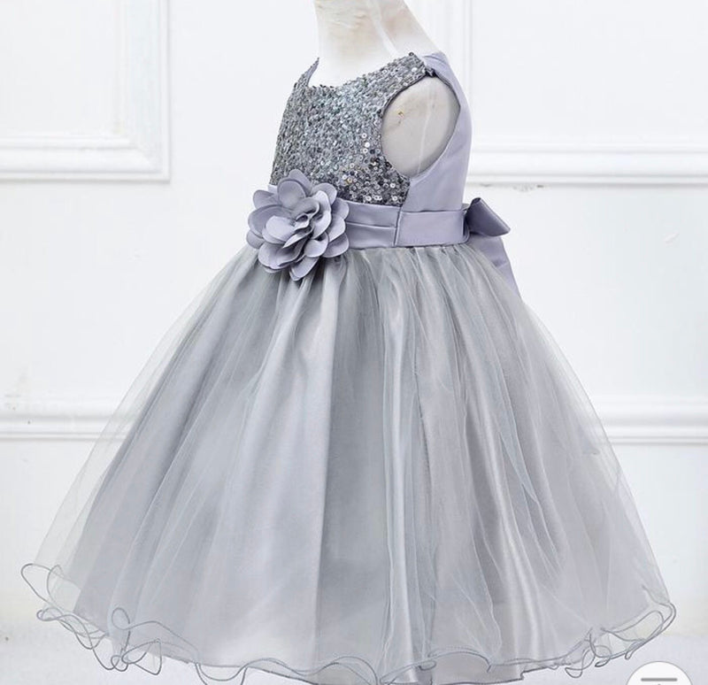 Silver dress with sequin upper, tulle skirt and removable flower