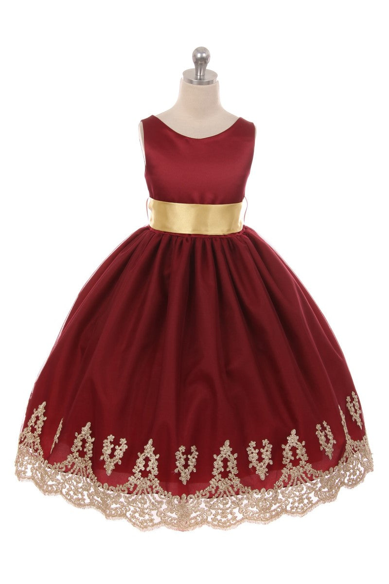 Burgundy dress with gold sash and gold trim