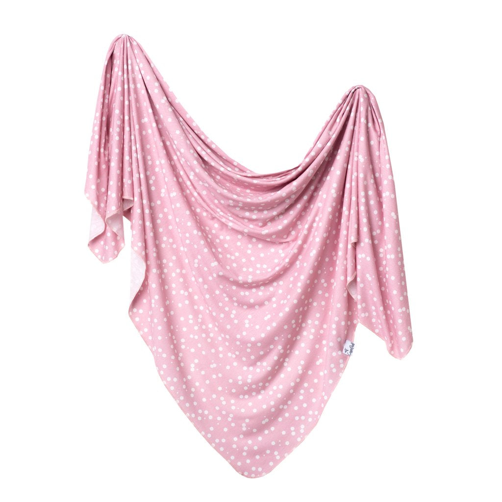 Pink and white polka dot swaddle blanket by Copper Pearl