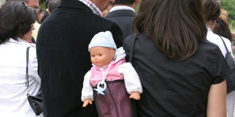 take a lifelike baby doll outdoor